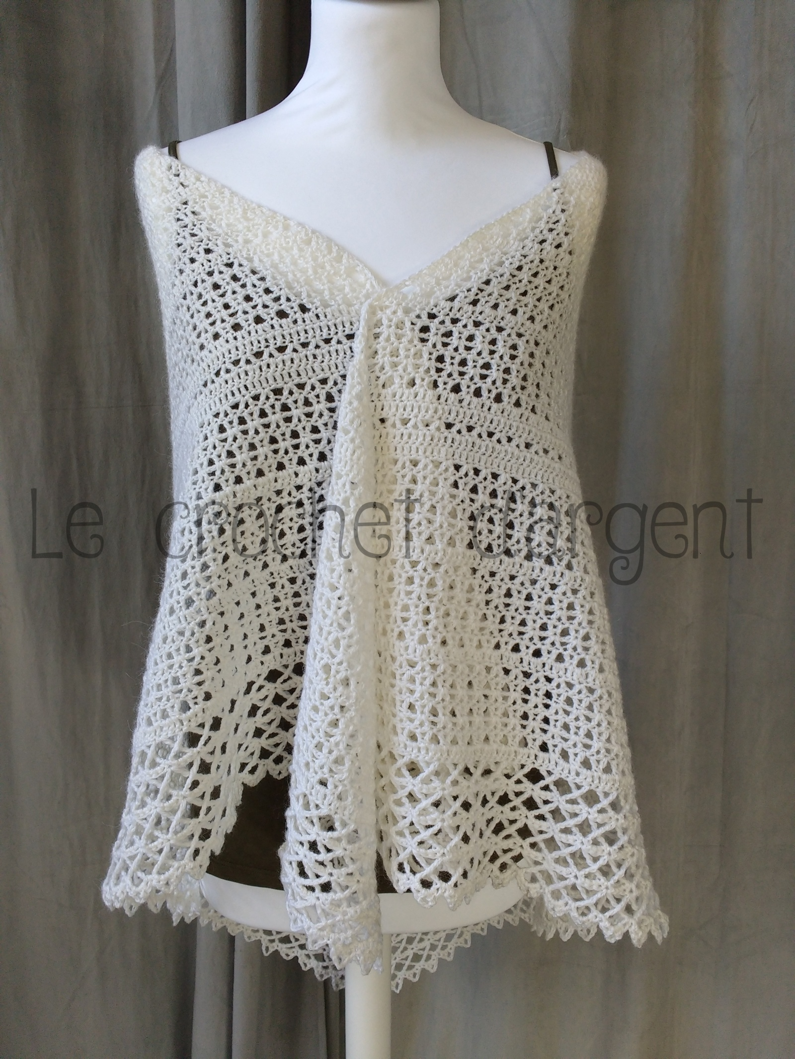 A beautiful white crochet shawl, with free pattern